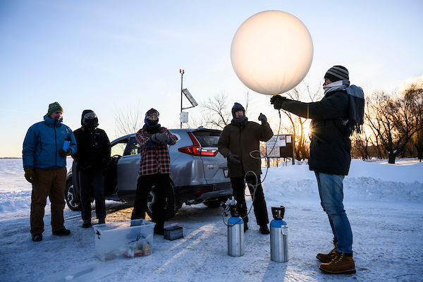 Professor Grant Petty and students launching a weather balloon.