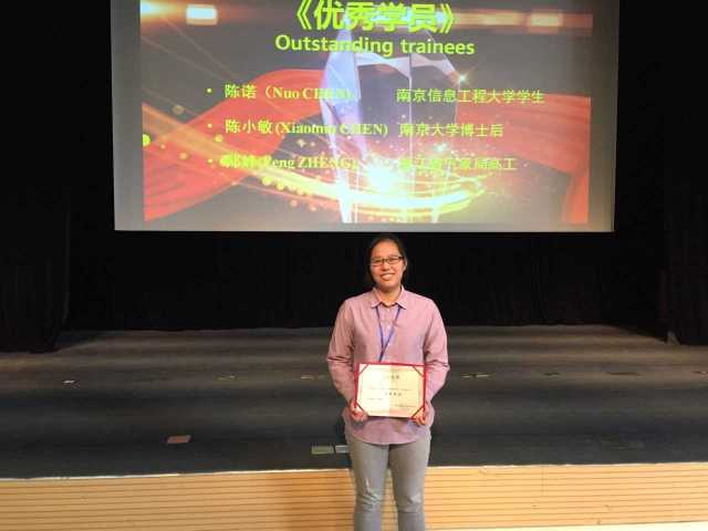 Picture of Nuo Chen receiving the Outstanding Trainee award